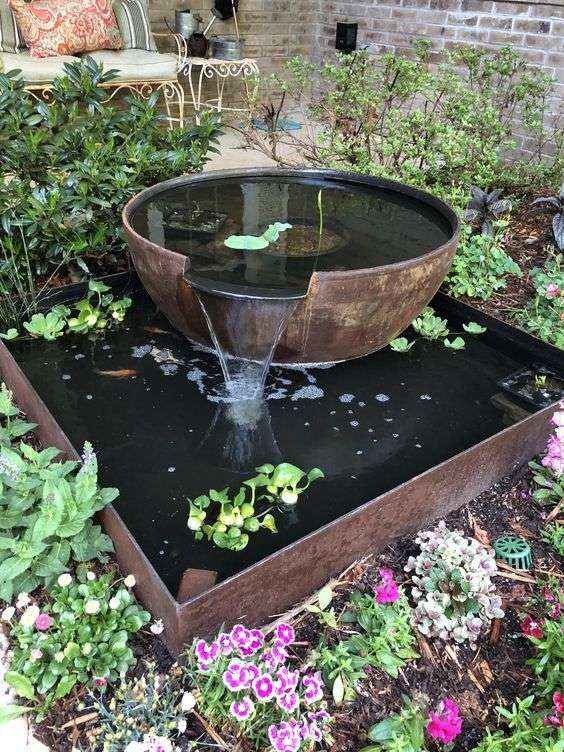 pretty cast iron water feature