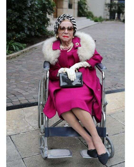 old glamorous lady in wheelchair