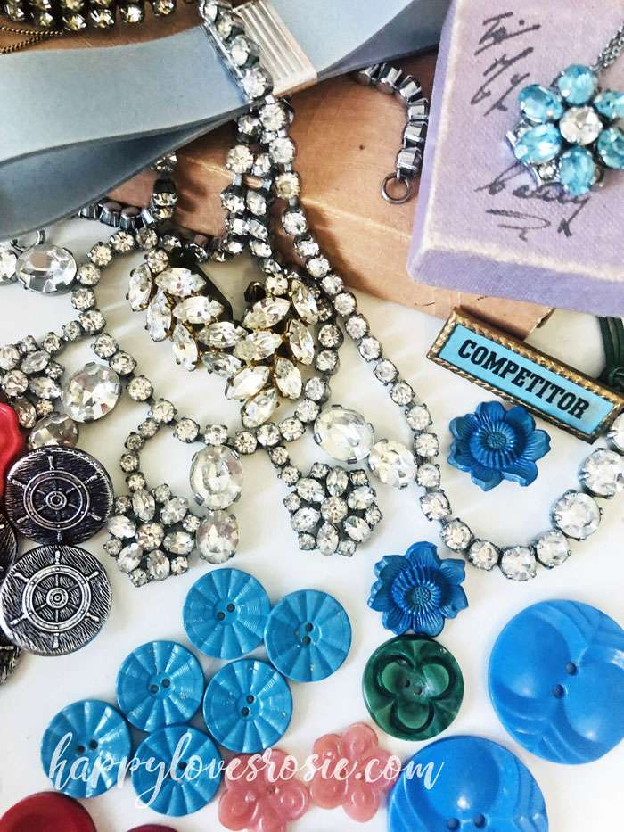 buttons and jewellery laying on a table