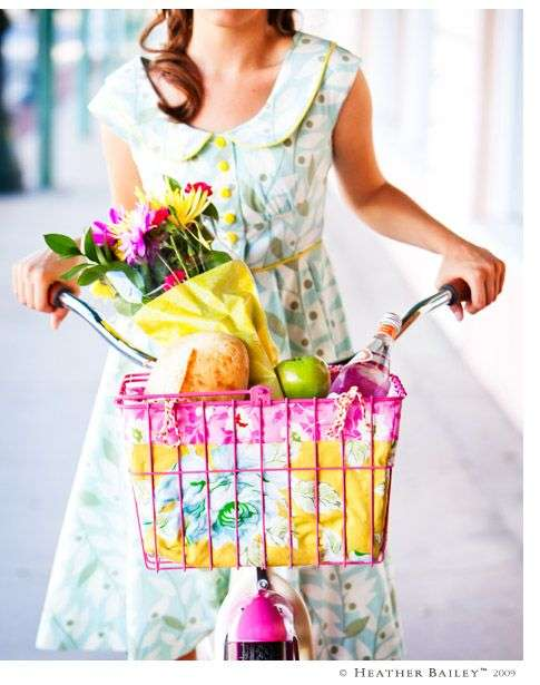 lady on bike and a basket full of flowers