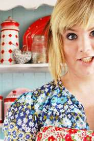 girl pulling a face in a colourful kitchen