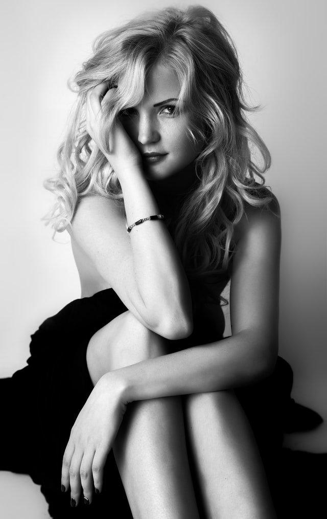 pretty blonde lady sitting