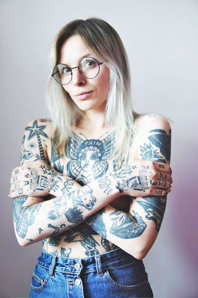 tattoo'd lady holding arms