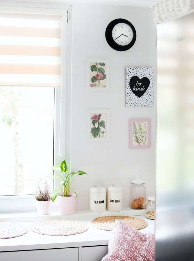 a room with white walls and pictures