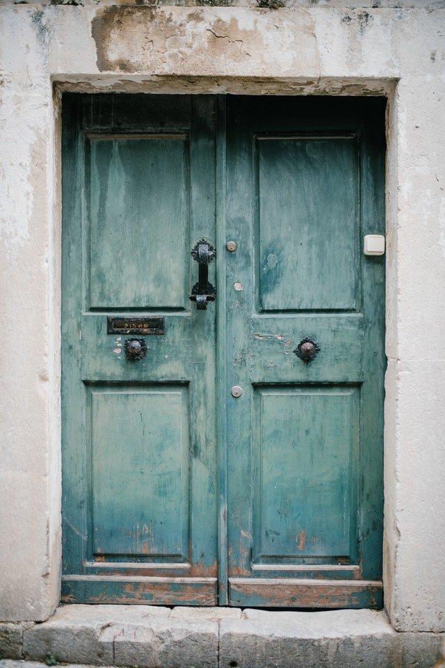 old decrepid green double doors