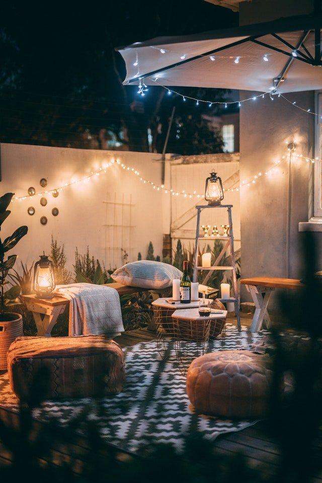garden patio with umbrella and lights