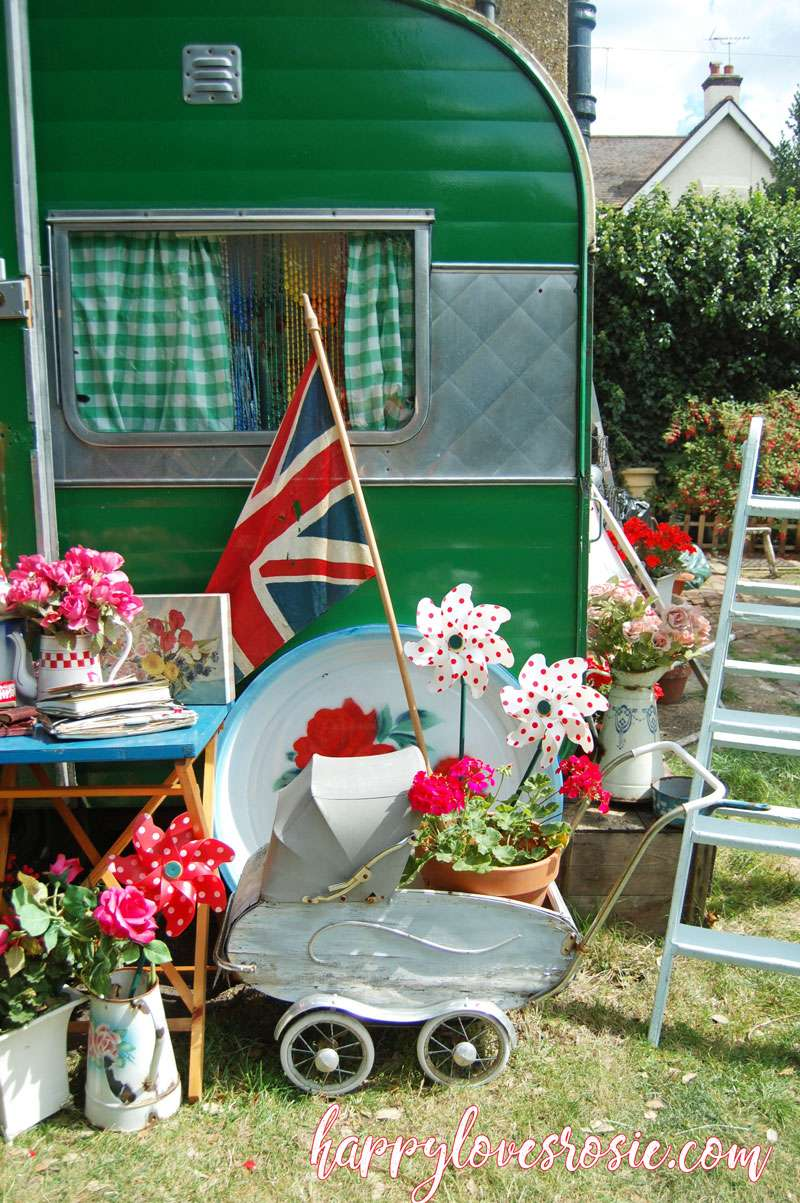 green caravan with shabby chic collectables